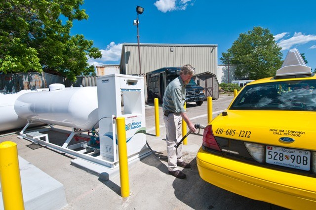 A Veolia Transportation propane autogas taxi filling up at an Alliance AutoGas station.