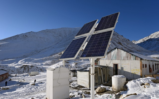 Solar panels on top of a snowy mountain in Ladakh, India
