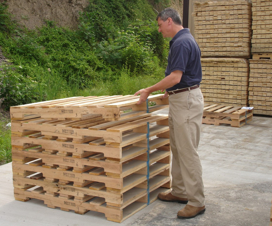 Chuck Ray, associate professor of ecosystem science and management at Penn State University, inspects a pule of wooden pallets.