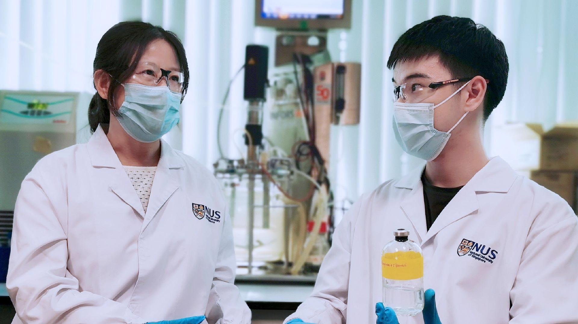 The team led by Associate Professor He Jianzhong (left) and Research Fellow Dr Wang Qingkun (right) discovered Thauera sp. strain SND5 after they isolated and tested various strains of bacteria from wastewater samples. Dr Wang holding a wastewater sample containing the unique SND5 bacterium.