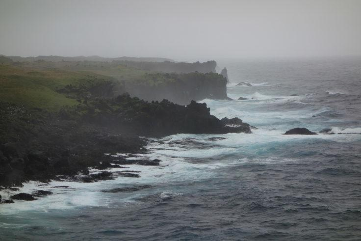 The coast of sub-Antarctic Marion Island. Sea spray is washed over the land and into nearby lakes.